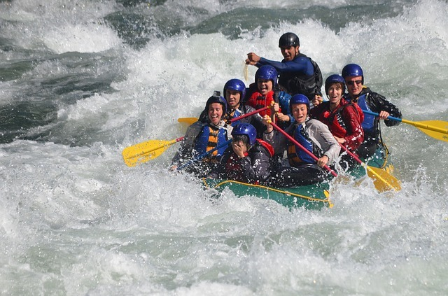 People enjoying team cohesion in rafting