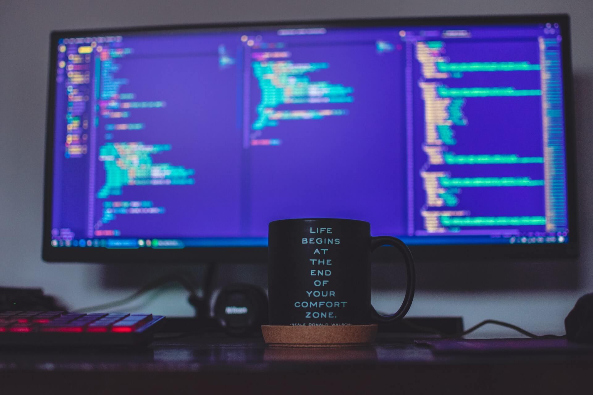 Computer screen with coffee mug