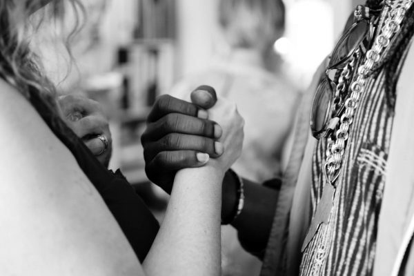Handshake of people from diverse ethnic backgrounds